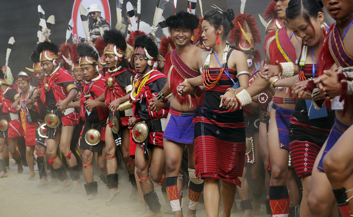 India's Naga tribe dancers in traditional attire, perform a dance during the Hornbill festival at Kisama village on the outskirts of Kohima, Nagaland, India. The 10-day long festival named after the Hornbill bird is one of the biggest festivals of India's northeast that showcases the rich tradition and cultural heritage of the indigenous Nagas.