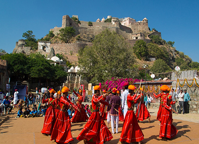 An image of annual festival of kumbhalgarh in Rajasthan, with Kumbhalgarh fort in the backdrop.